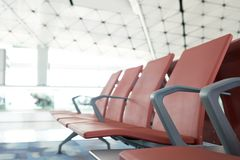 Waiting chairs of passengers in red airport. The background is the atmosphere in the airport. For passengers waiting to leave or m. Ay lie in the airport. as Stock Photography