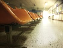 Waiting chairs zone in hospital. With light from doorway Royalty Free Stock Photos