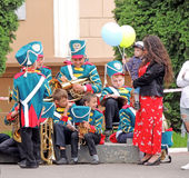 Waiting of children's brass band for their performances Royalty Free Stock Images