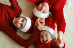 Waiting for christmas. Mother with her daughters waiting celebrate Christmas stock photography
