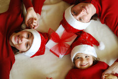 Waiting for christmas. Mother with her daughters waiting celebrate Christmas Stock Image