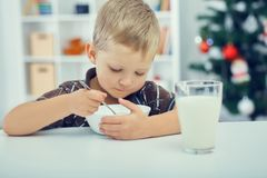 Little boy eating breakfast on the eve of the new year. Waiting for Christmas. Waiting for Christmas. Little boy eating breakfast on the eve of the new year Royalty Free Stock Images