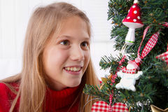 Waiting for the Christmas - young girl with christmas tree Stock Images