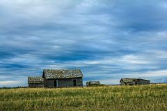 Waiting for the coming storm. Abandoned farm buildings, rural Alberta, Canada Royalty Free Stock Photos