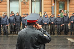 Waiting for a command, Russian police. Double police line is bordering march of democratic opposition in St.Petersburg at May, 1, 2010. In few minutes policemen royalty free stock photos