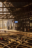 Waiting commuters at a railway station Stock Image