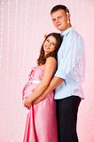 We are waiting for completion of the family. Husband and pregnant wife Stock Images