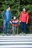 Waiting by the Crosswalk. Family waiting to walk safaty to the Crosswalk royalty free stock image