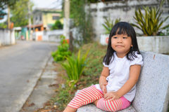 Waiting. Cute Asian girl waiting her mother Stock Images