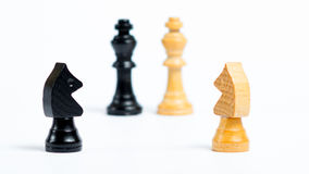 Waiting for decision. Chess figures in front of white background - Concept of decision making - Knights are waiting for a command from the king Royalty Free Stock Images