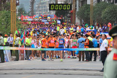 Waiting for departure. Runners waiting for departure.Half international marathon in fushui county in yunnan province in China, time: on September 25, 2013 Stock Photo