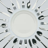Waiting for Dinner. Empty plate with knives, forks and spoons around Vector Illustration