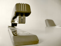 Waiting for documents. An old tired staple is waiting for somebody to work and use it for new documents Stock Images