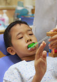 Waiting for enamel fluoride gel application Royalty Free Stock Photography