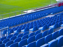 Waiting for the event. Blue chairs in a soccer stadium Stock Image