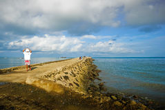 Waiting for the fishing boat to arrive. Stock Image