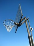 Waiting for a game to start. Perfect day for playing basketball. New basketball backboard and clear sky royalty free stock photos
