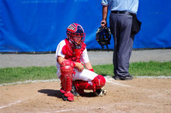 Waiting for the Game to Start. Baseball Catcher waiting for the game to start Stock Photos