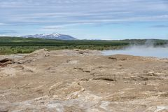 Waiting for Geysir to erupt. In Iceland stock photo