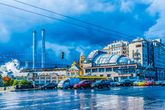 Waiting for the green light on the blue day. Automobiles by the traffic light on a Small Stone Bridge over the bypass canal of the Moscow river. One hundred royalty free stock photo