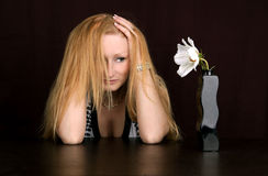 Waiting growth. Upset bored woman looking at crowing bloom royalty free stock image