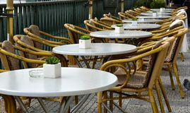 Chairs and tables in a row royalty free stock photography