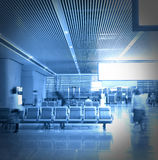 Waiting hall. Luggage and passengers walking in the waiting hall Stock Photo