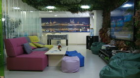 Waiting Hall with Large TV Screen on Wall and Cosy Sofa. KAZAN, TATARSTAN/RUSSIA - JUNE 08 2015: Modern waiting hall with large TV screen on wall and comfort stock video