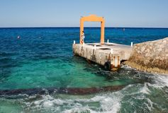 Waiting At The Harbour. A girl is waiting at the little harbour on Cozumel island, Mexico Royalty Free Stock Images