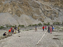 Waiting for helicopters. Tourists isolated by the august 2010 floods in the Skiu village, Ladakh region, Indian Himalaya, Jammu and Kashmir state, are arranging Stock Images