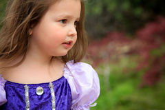 Waiting for her prince. Pretty little girl in princess dress looks for her prince charming Royalty Free Stock Images