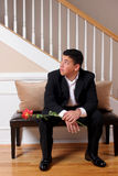 Waiting for his date. A young man watches and waits for his date to be ready stock images