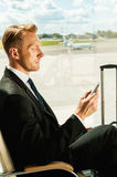 Waiting for his flight. Royalty Free Stock Photo