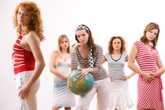 Waiting for holiday. Five attractive young girls in summerclothes ready for their holiday trip Stock Photography
