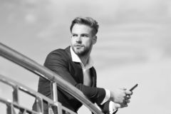 Waiting important call from partner. Businessman use smartphone for video call or texting sky background. Man in suit. Businessman takes advantages of modern stock images