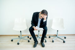 Waiting for a job interview. A man candidate is waiting for his job interview royalty free stock photography