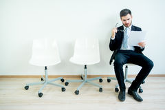 Waiting for a job interview. A man candidate is waiting for his job interview Royalty Free Stock Photos