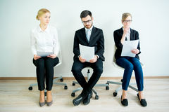 Waiting for a job interview. Three candidates are nervously waiting for a job interview royalty free stock photography
