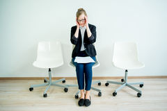Waiting for a job interview. A woman candidate is waiting for her job interview royalty free stock photography