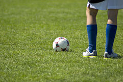 Waiting for kickoff. Image of a young female soccer player, waiting for kickoff Stock Photos