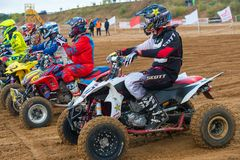 Waiting for launch. SERPUKHOV, RUSSIA - OCTOBER 7, 2017:  Athletes at the start, Class ATV, in the 4 stage  MX series, the Red Wings Cup 2017 super country-cross Royalty Free Stock Images