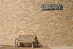Waiting at Library with Sign Overhead Stock Image