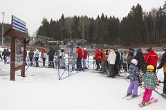 Waiting lift queue people in ski resort. KUROVO, DMITROVSKY DISTRICT, RUSSIA – CIRCA JANUARY 2012: Ski resorts Sorochany and waiting queue people in Moscow Royalty Free Stock Photography
