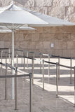 Waiting in line. View of umbrellas and line dividers for crowds Royalty Free Stock Photography