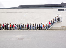 Waiting in Line. Large group of people waiting in line Royalty Free Stock Images