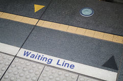Waiting line. Taipei MRT station platform edge. Painted waiting line on the floor Royalty Free Stock Photos