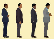 Waiting In Line. Black business men waiting in line Stock Photography