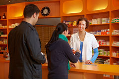 Waiting in line in pharmacy. Two customers Waiting in line in pharmacy for the pharmacist Royalty Free Stock Photography