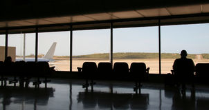 Waiting lounge. Male silhouette in the waiting lounge in airport Stock Photo