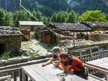 Waiting for lunch in Bhratang village, Nepal stock photo